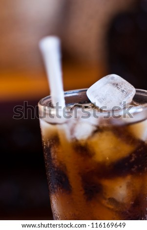 ice in glass of cola - stock photo