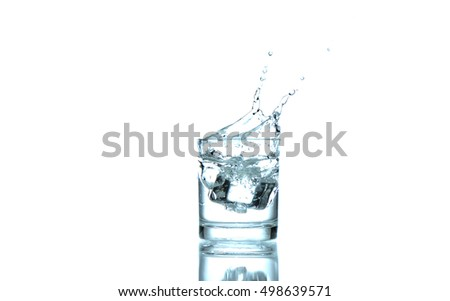 Ice in glass  with splash water on white background