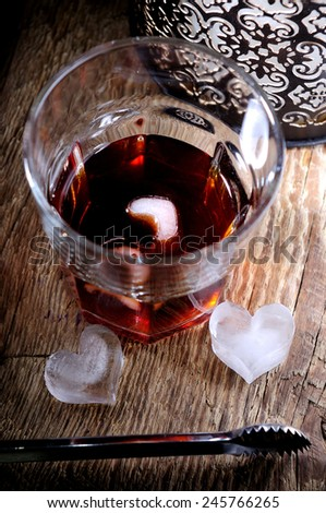 ice in the form of heart on the bottom of the glass - stock photo