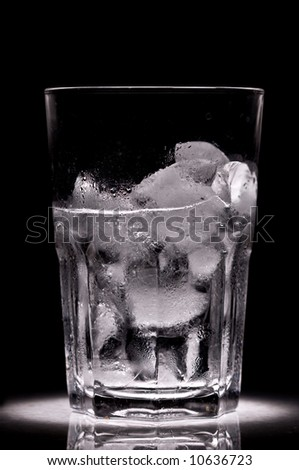 Ice in the glass for cocktail over black