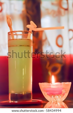 Ice juice, candle light illuminate it
