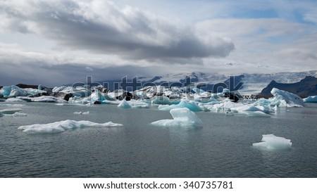Ice lake, ice blocks, and glacier at Jokulsarlon Iceland - stock photo