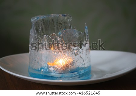 Ice lantern with candle - stock photo