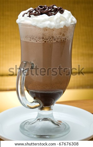ice latte frappuccino in a big cup with cream and chocolate - stock photo