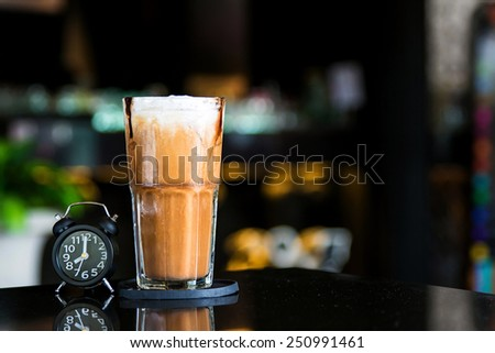 Ice latte with coffee shop background - stock photo