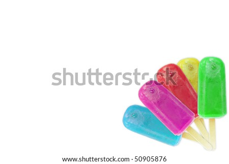 Ice lollies in different colors and flavors isolated over white background - stock photo