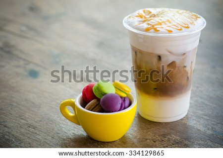 ice macchiato coffee and macaroons in cup - stock photo