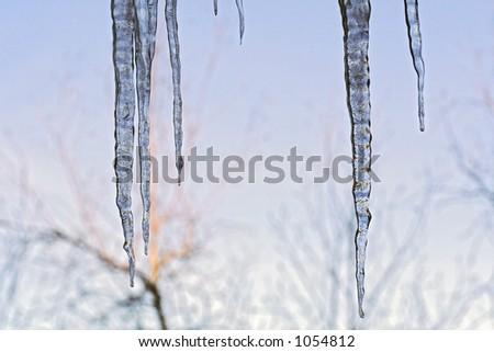 Ice melting and freezing causing beautiful icicle formations. - stock photo