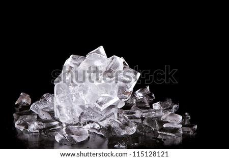 Ice melting on black background - stock photo