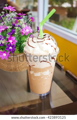 Ice mocha frappe with whip cream in plastic glass. Take away package. - stock photo