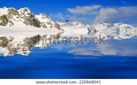 Ice mountain and reflection with blue skies - stock photo