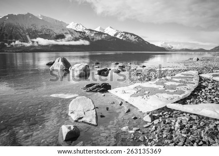 Ice on an Alaskan beach in black and white. - stock photo