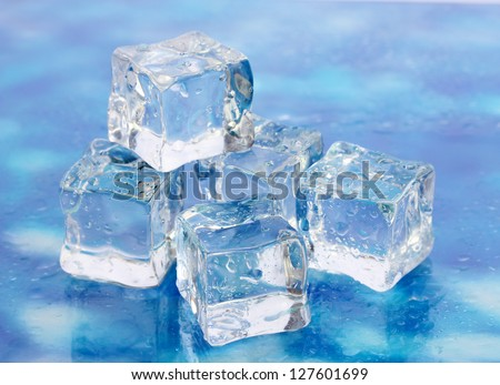 Ice on brightblue background - stock photo