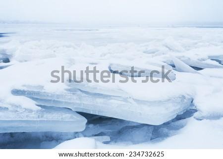 ice on river closeup of big blocks, selective focus - stock photo