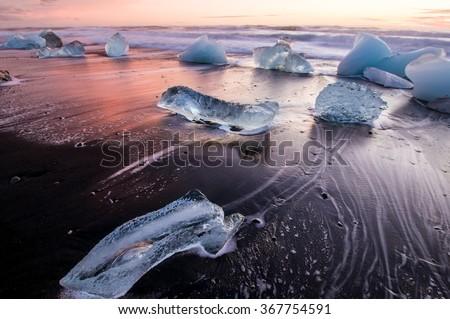 Ice on the black volcanic beach near Jokulsarlon glacier lagoon, winter Iceland - stock photo