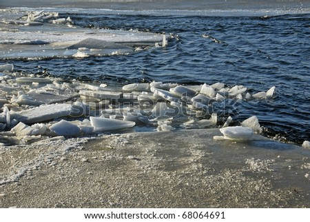 Ice on the sea, breaking up - stock photo