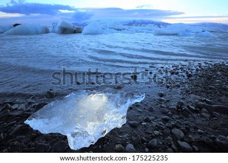 ice on the shore of glacier lake Jokulsarlon, Iceland - stock photo