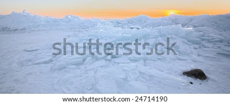 Ice pack pastel sunset from the north shore of Lake Superior - stock photo
