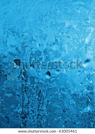 ice patterns and drops on glass - stock photo