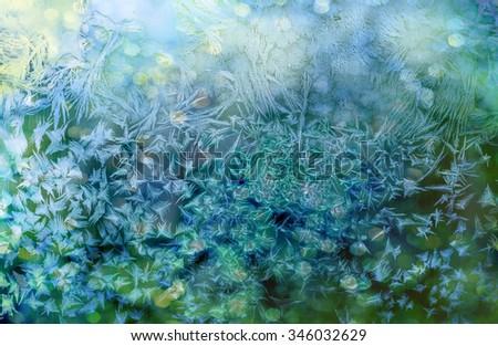 Ice patterns on winter glass.Winter background - stock photo