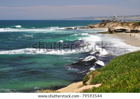 Ice plant mixes with rocky ledges along the coastline of La Jolla, California. - stock photo