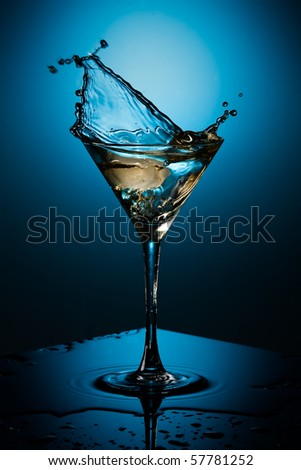 ice plash, cocktail and the blue background - stock photo