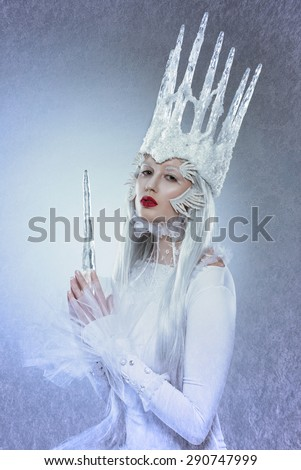 Ice queen with crown made of ice - stock photo
