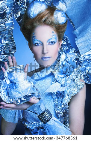 Ice-queen. Young woman in New Year  image with silver artistic make-up. - stock photo