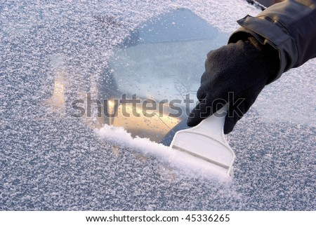 ice scraping - stock photo