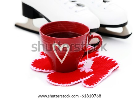 ice skate with cup of hot tea and gloves on white - stock photo