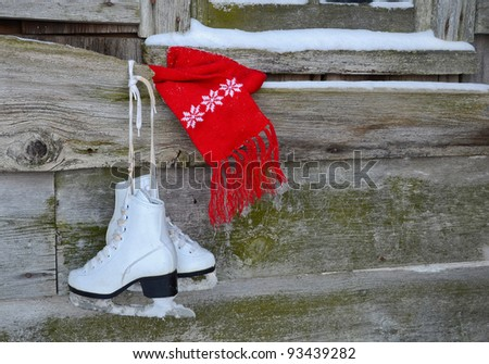 ice skates with red scarf - stock photo