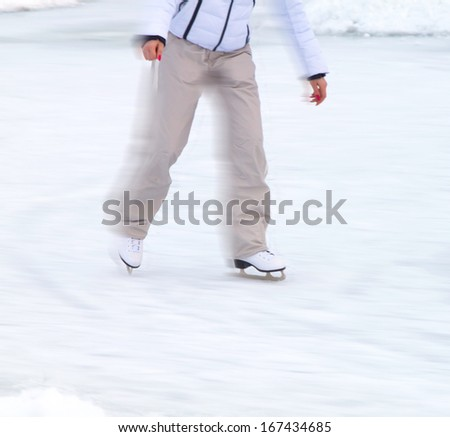 ice skates with reflection on winter ice - stock photo