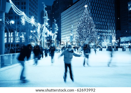 Ice Skating at Christmas (motion blur) - stock photo