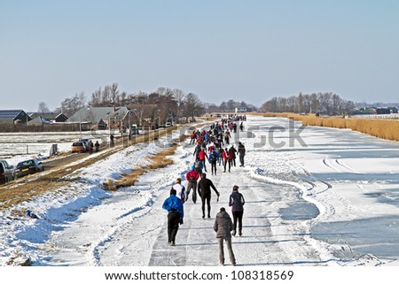 Ice skating in the countryside from the Netherlands - stock photo