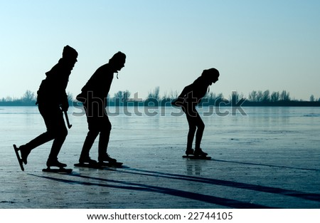 ice skating in the netherlands - stock photo