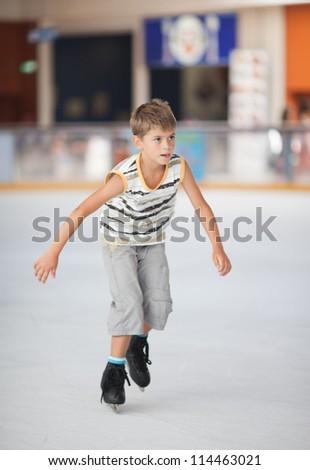 Ice skating little boy - stock photo