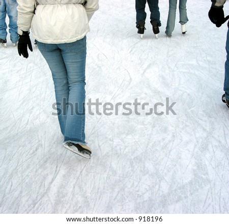 Ice skating on a city skating rink - stock photo