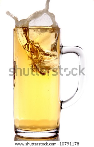 Ice splashing into a mug of beer