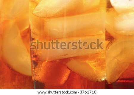 Ice tea  and ice cubes background - stock photo