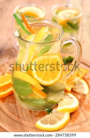 ice tea with citrus fruits - stock photo