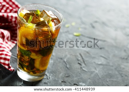 Ice tea with lemon and mint - stock photo