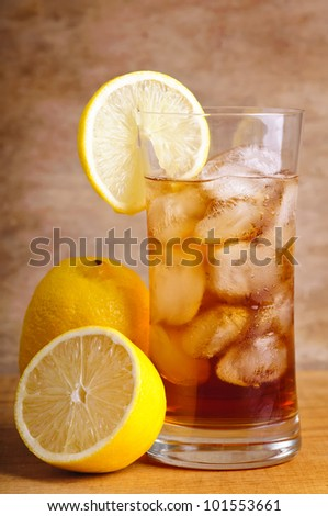 ice tea with lemon fruits on a wooden background - stock photo