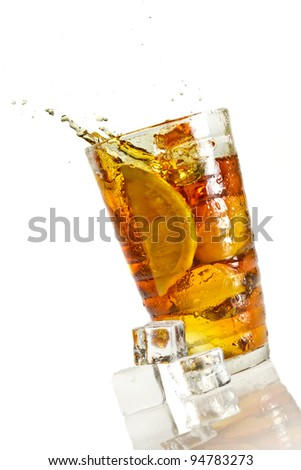 Ice tea with splash with cube - stock photo