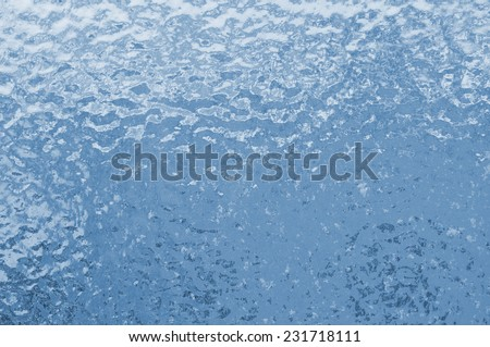 Ice texture. Frozen water drops on a window - stock photo
