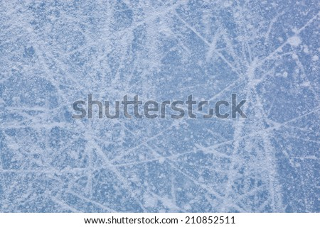 Ice texture of ice skating rink outdoors with snow - stock photo