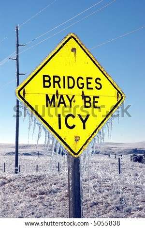 Ice Warning Sign on Highway Covered in Ice - stock photo