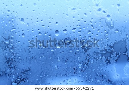 ice water drops on winter glass - stock photo