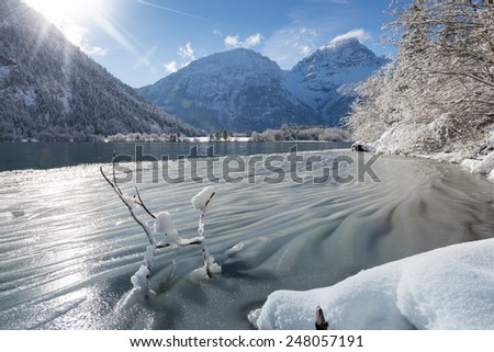ice waves at austrian lake in winter mountain landscape - stock photo