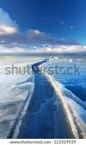 Ice way. Dark sky with clouds. - stock photo