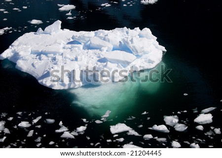 Iceberg above and below the water - stock photo